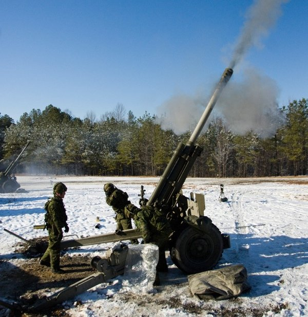 Canadian soldiers from the 1st and 3rd Field Regiments fire a 105 mm high explosive round with a C3 howitzer March 3, 2009, during Exercise Maritime Raider 09 at Fort Pickett, Va.